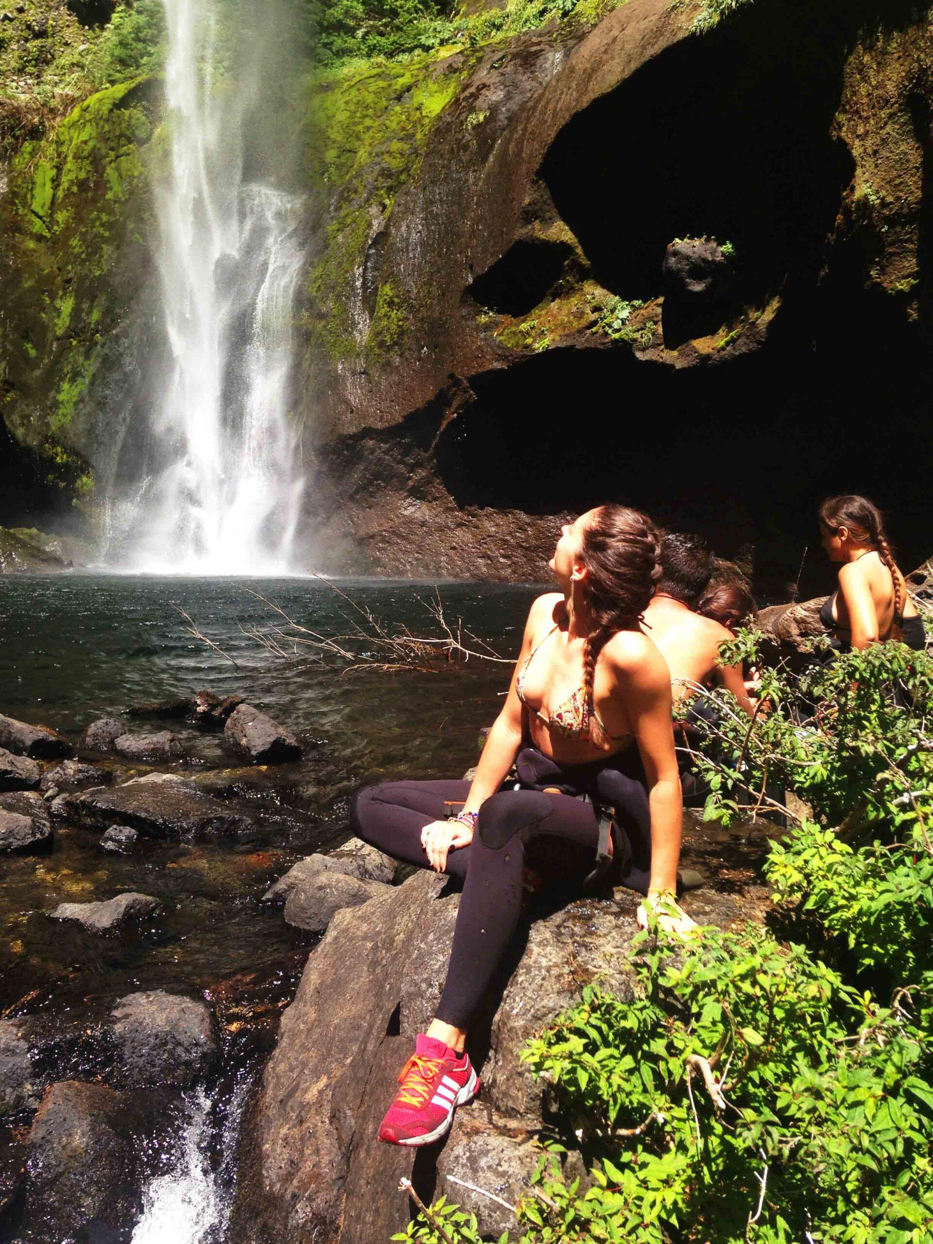 Waterfalls pucon girl on rock