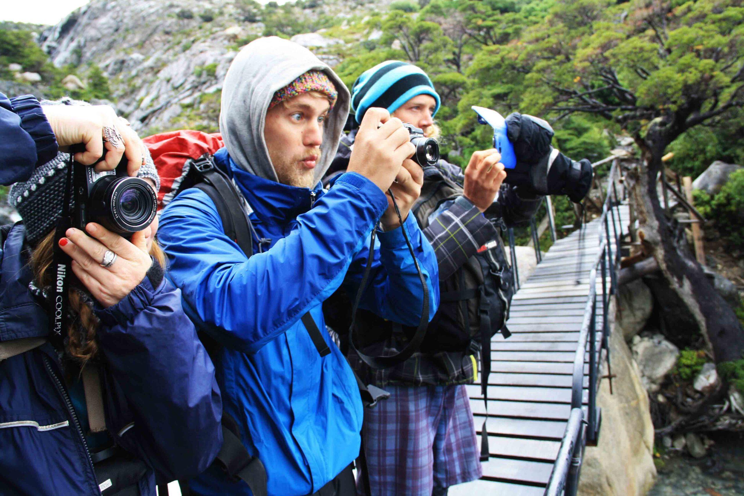 crew on bridge taking pictures