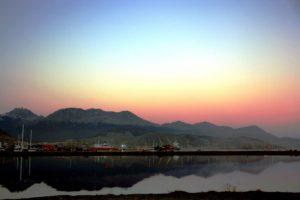 sunrise ocean mountains ships ushuaia