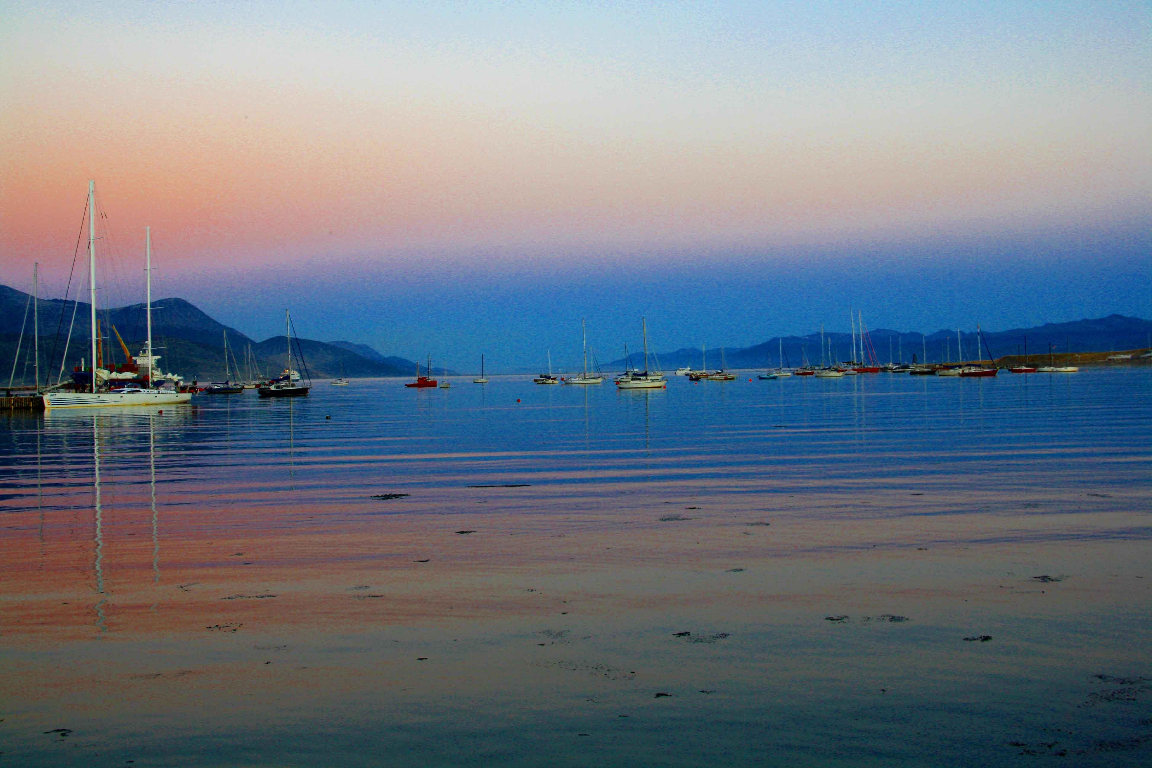 ushuaia boats ocean sunset mirror