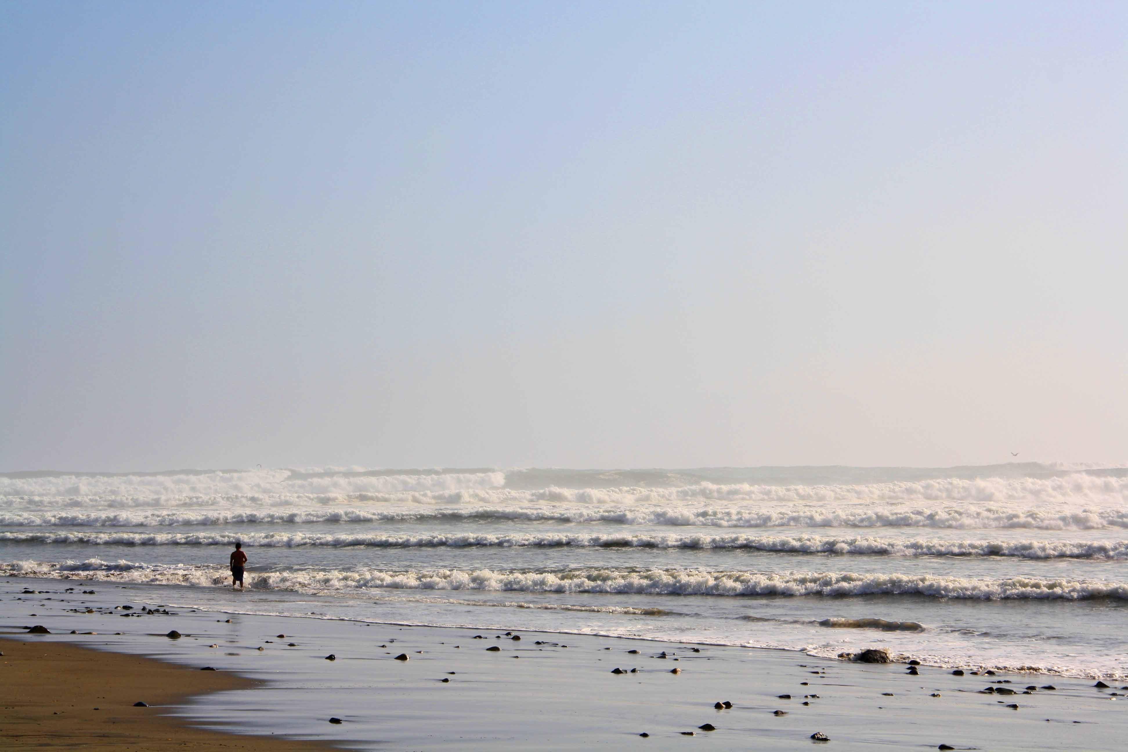 waves rolling in beach peru