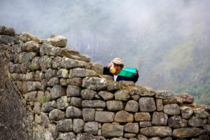 cleaner of the inca walls at machu picchu