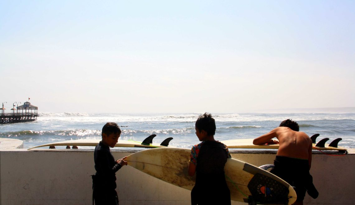 kids surfing surfboards peru