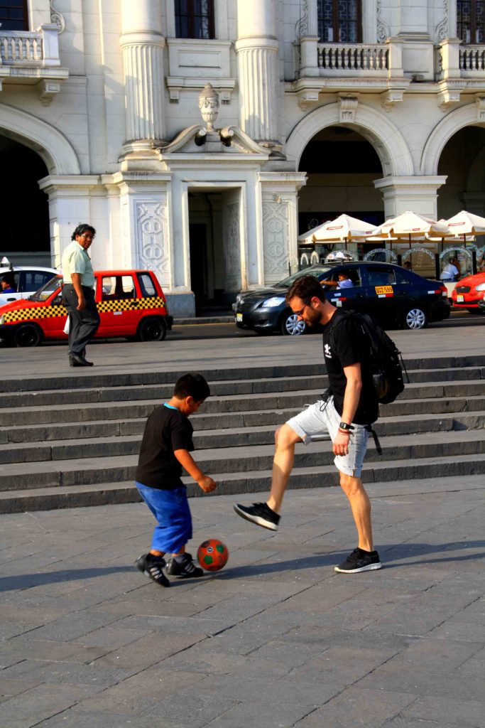 playing soccer in the streets of lima