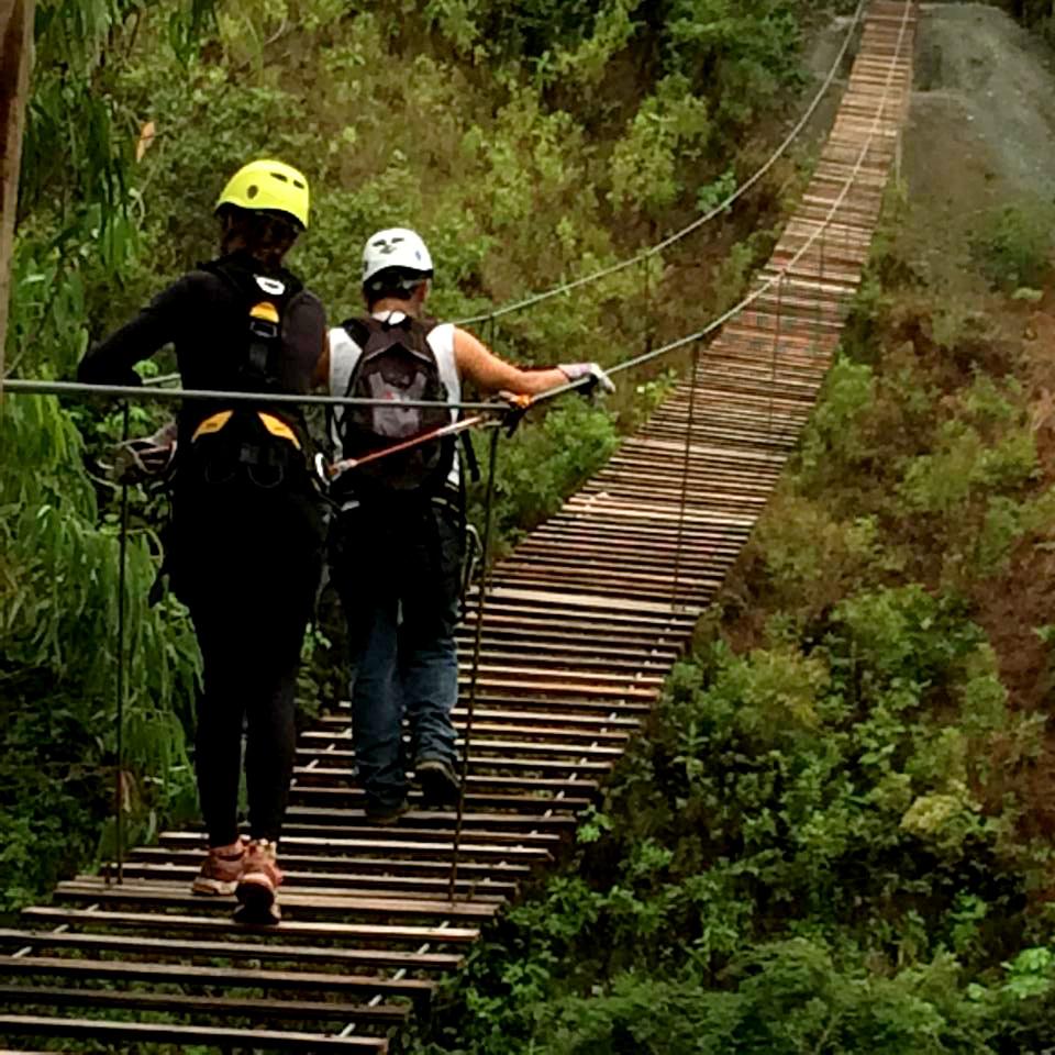 ziplining crossing bridge inca jungle trail Peru