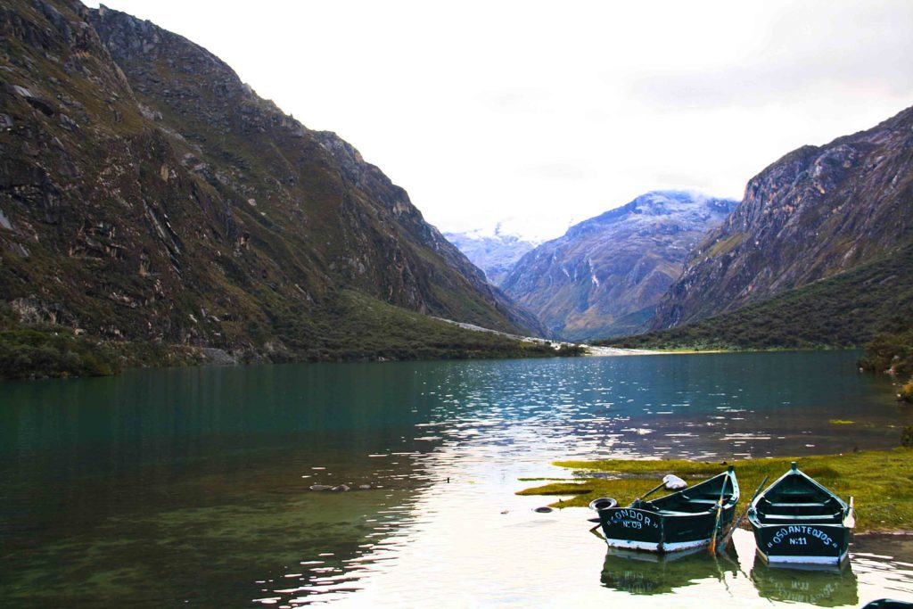 lake view with boats in the cordillera blanca