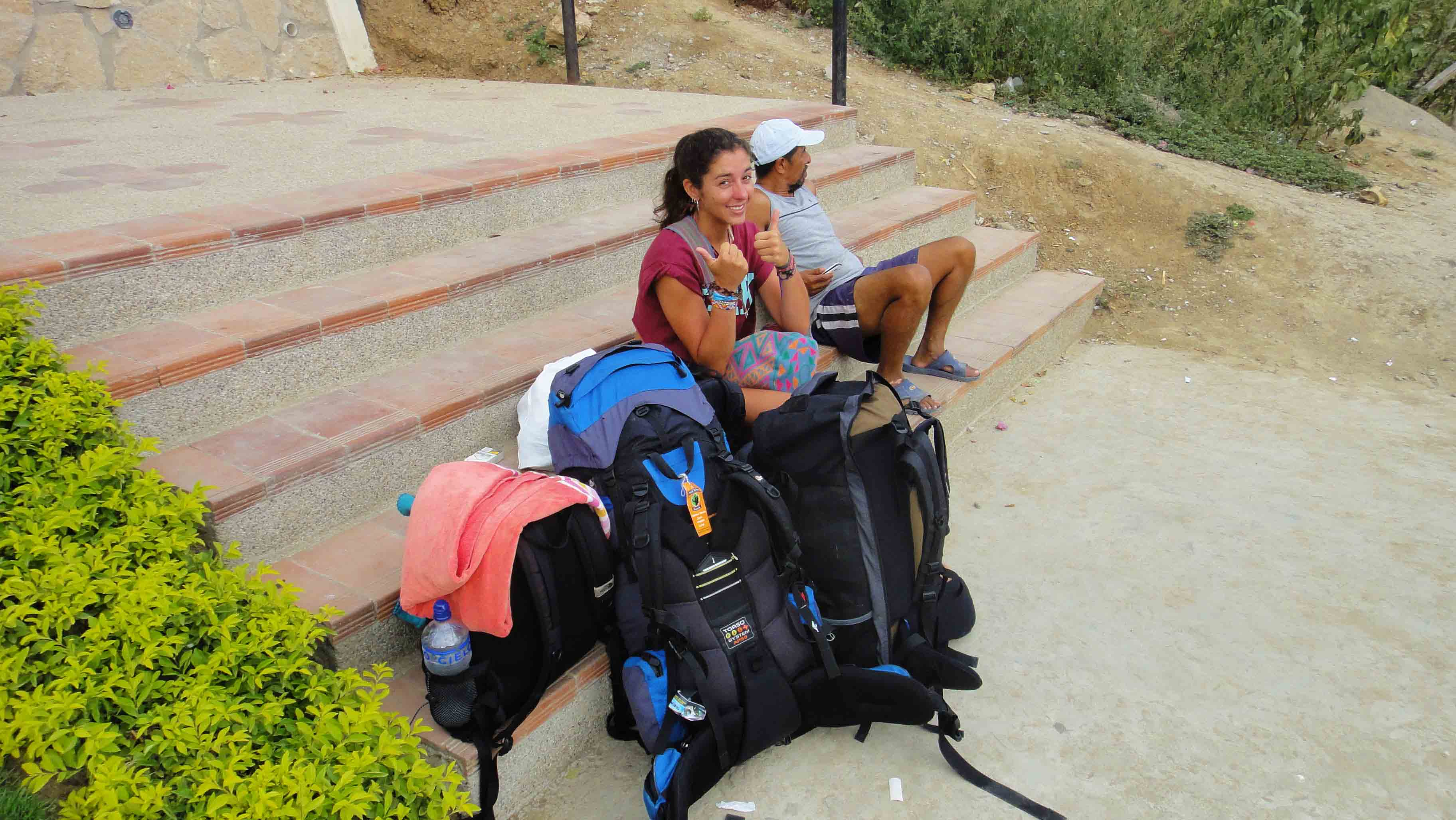 Backpacker waiting on bus