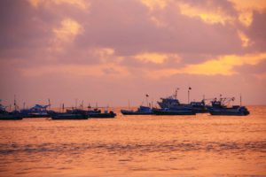 Boats sunset in puerto lopez