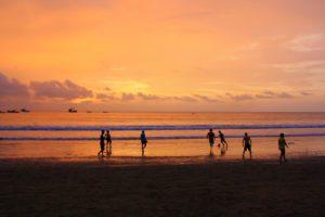 sunset soccer game on the beach in Ecuador