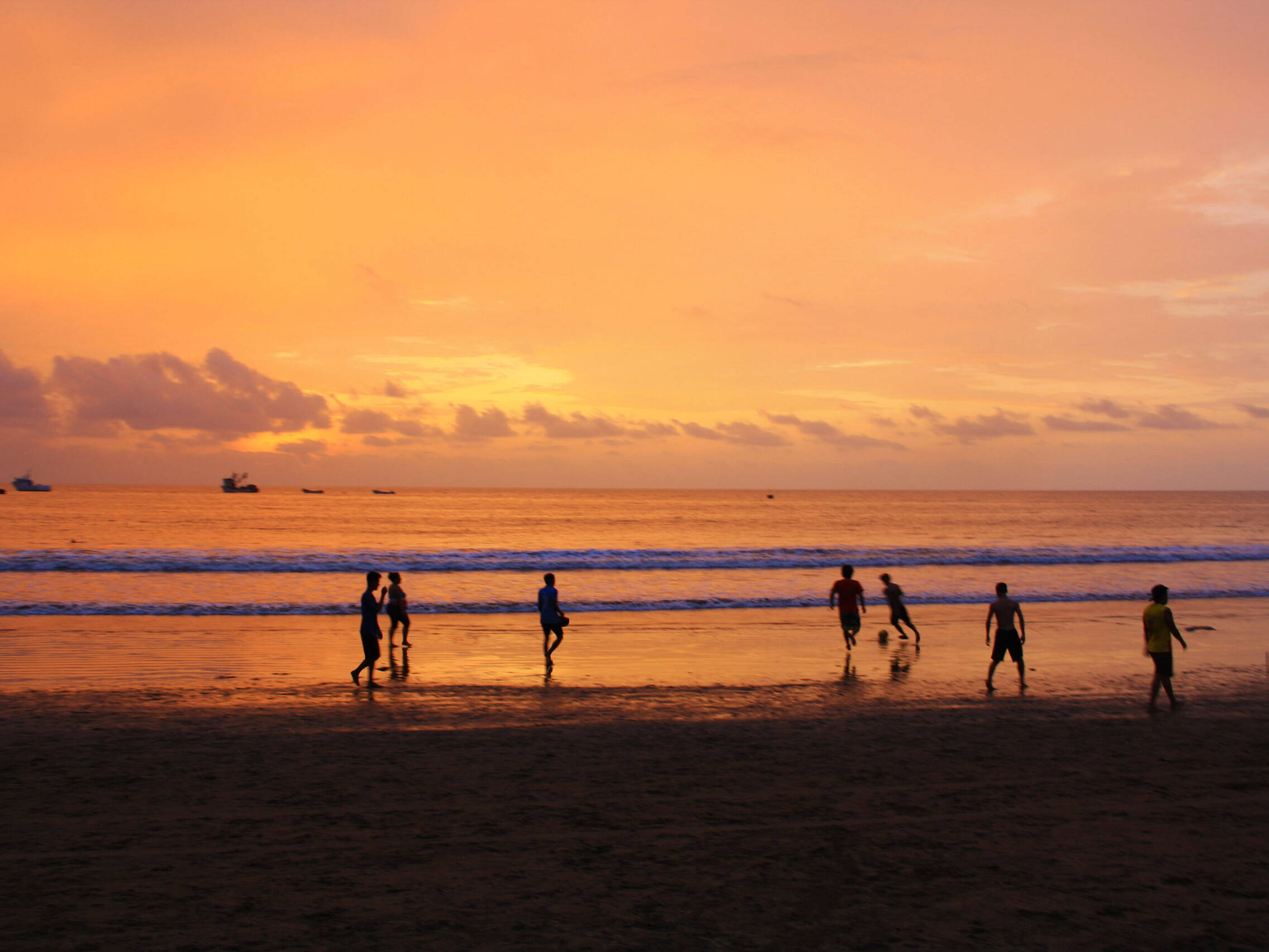sunset soccer game on the beach in Ecuador