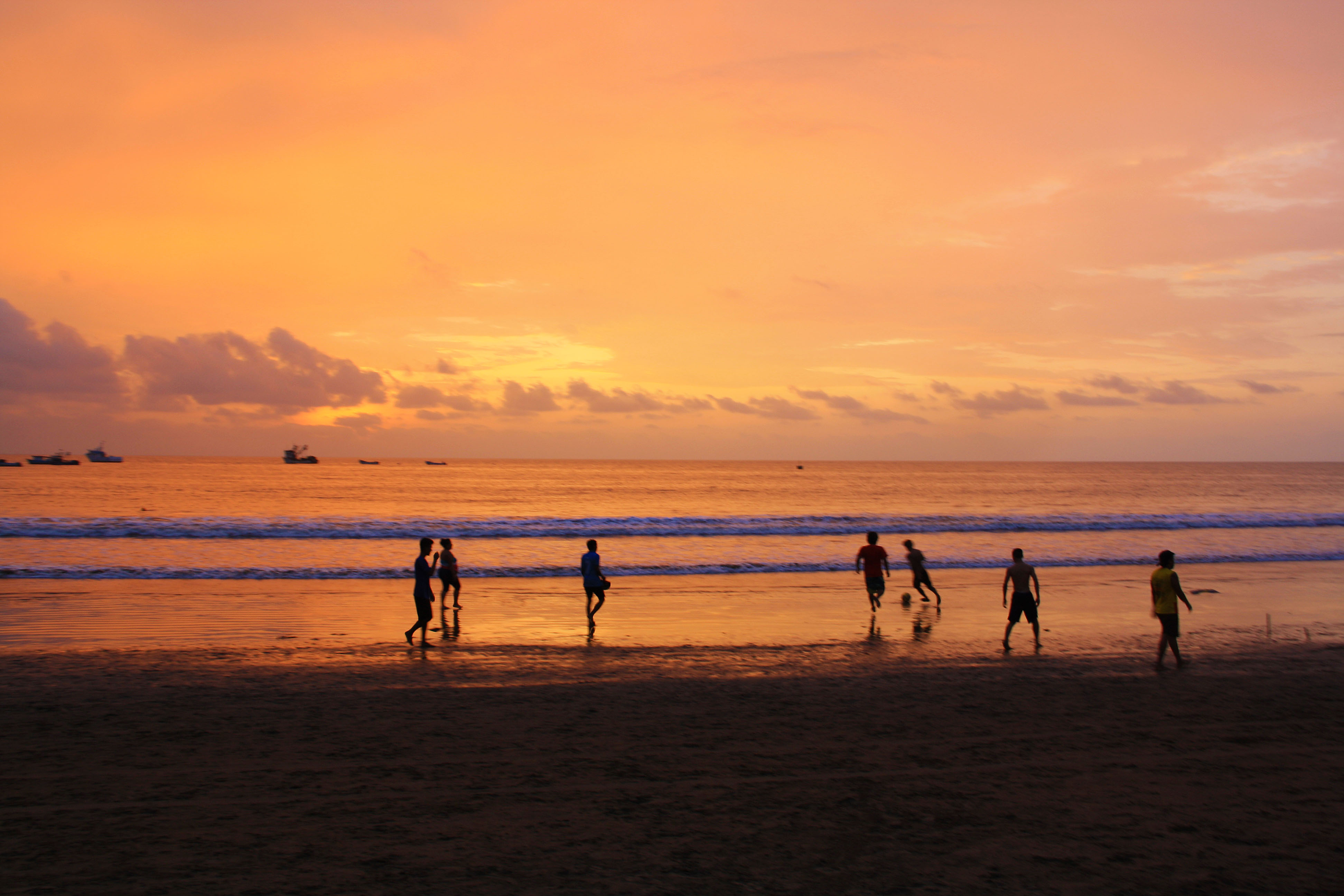 sunset soccer game on the beach