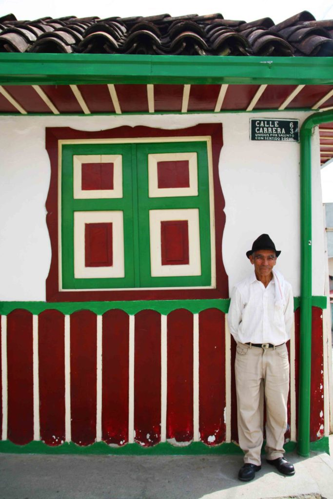 colombian man in front of house salento