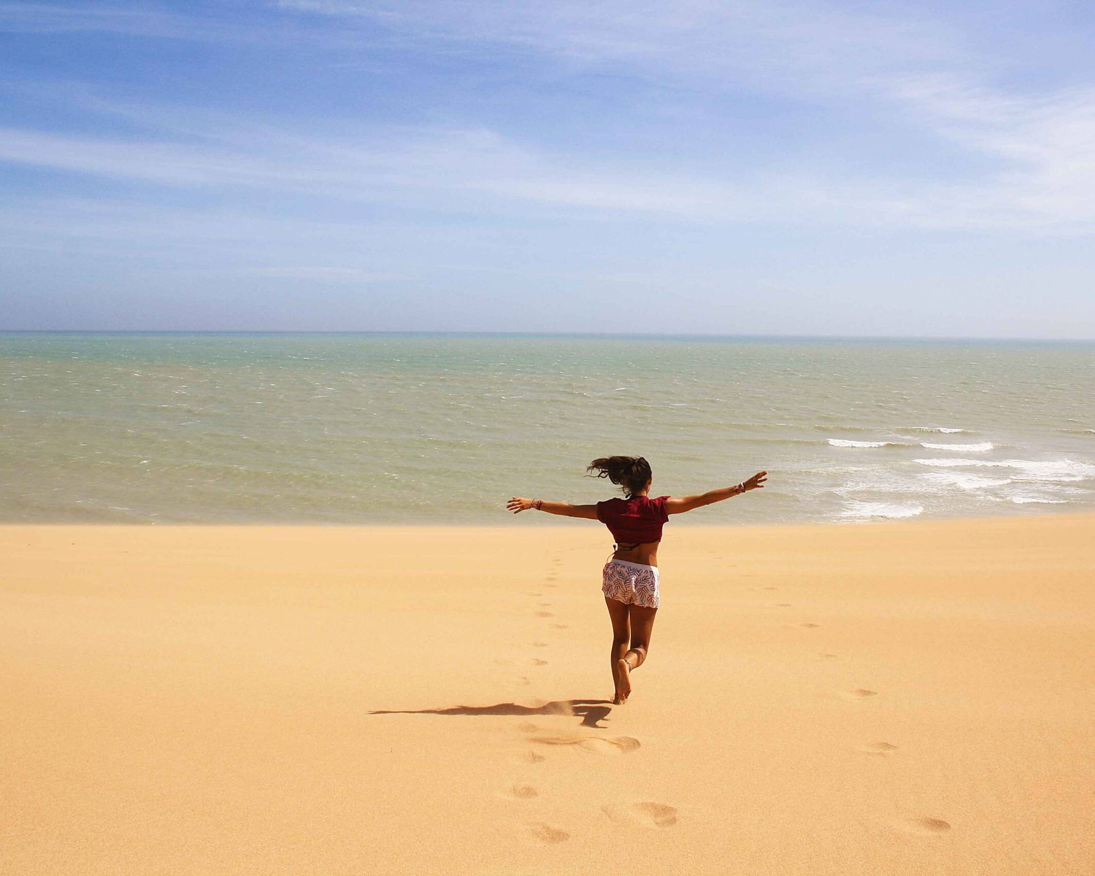 running in the desert dunes of Punta Gallinas Colombia