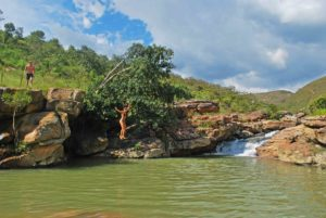 Cliff jumping at the Curiti swimming holes
