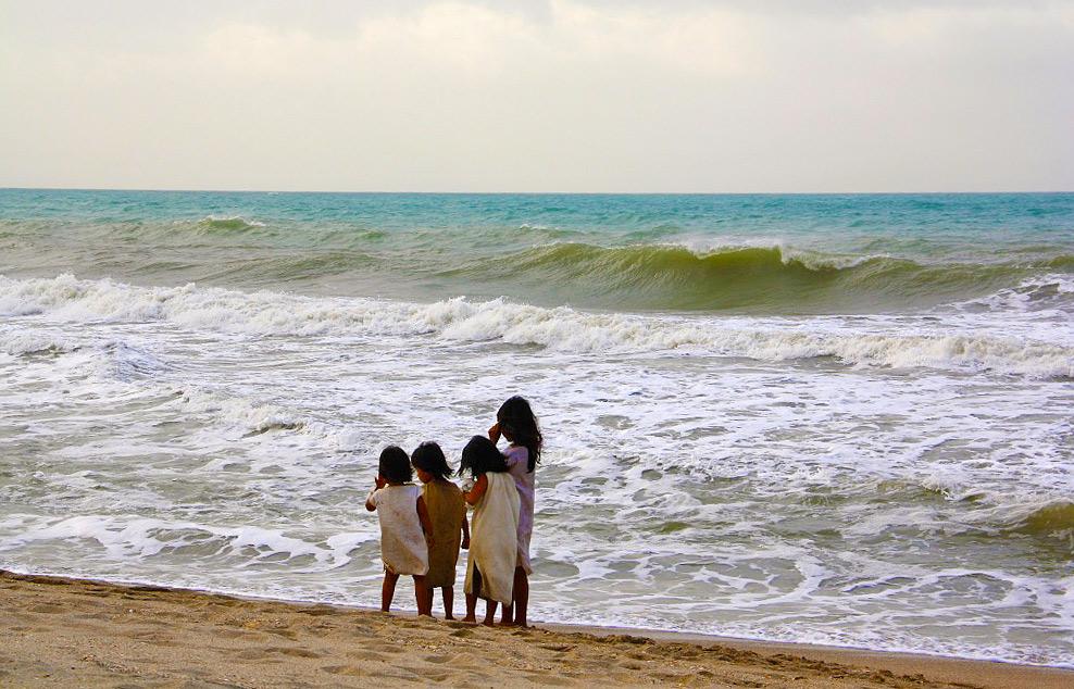 indigenous kids on the beach Palomino