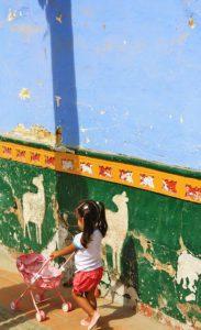 little girl walking the street of Guatape