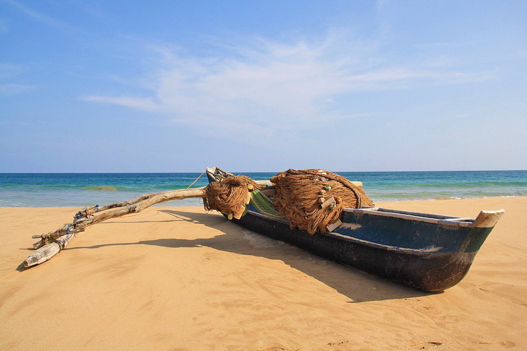 Fishing boat talalla beach sri lanka