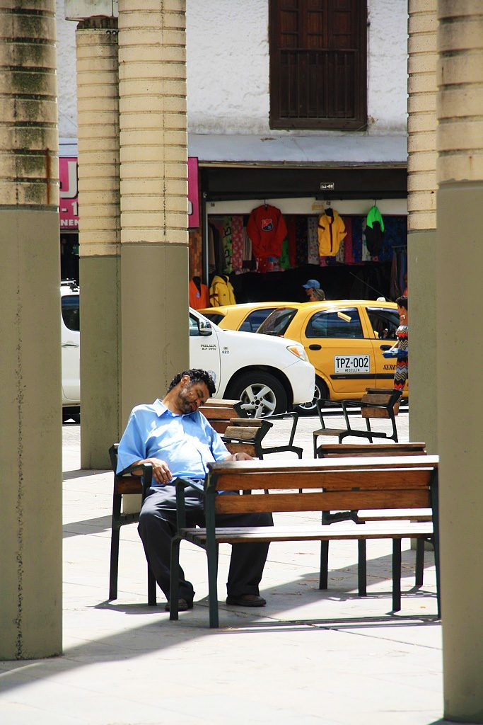 man sleeping at the square of hope