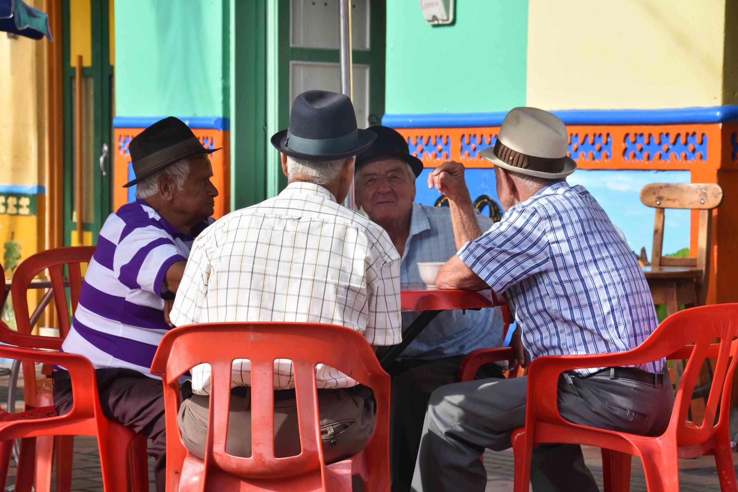 daily life in Guatape men with bowler hats