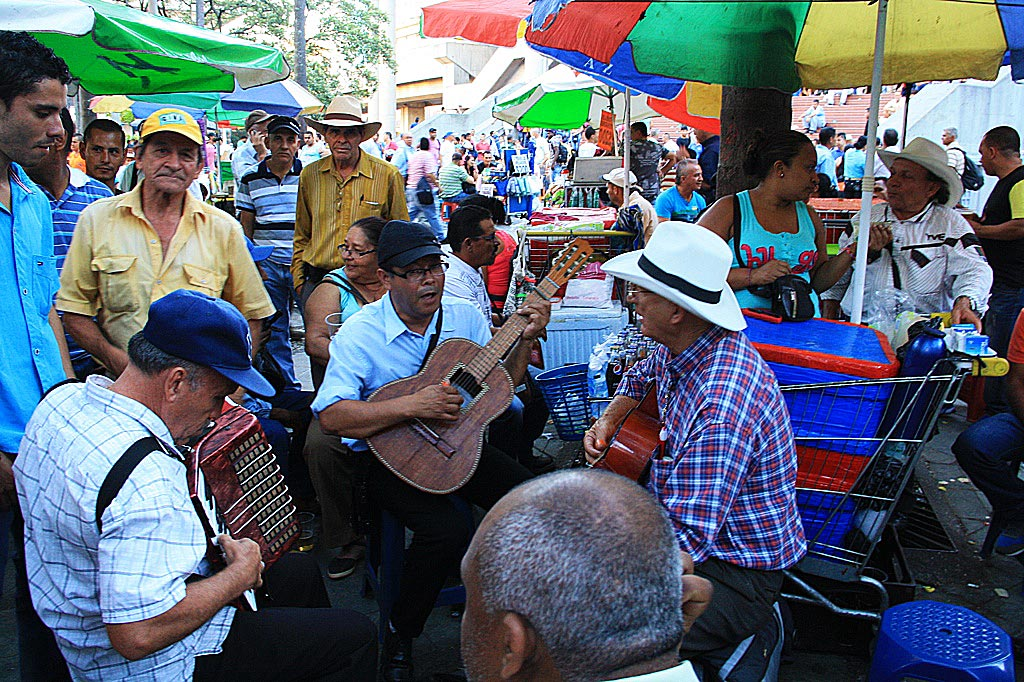men playing music on a square in medellin