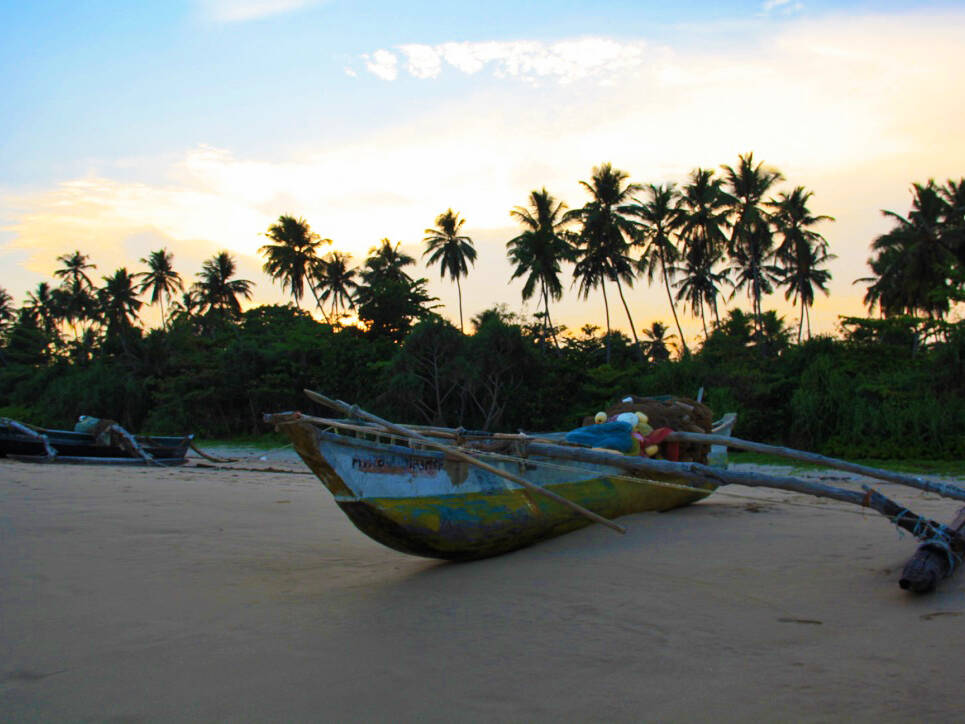 sky sunset talalla beach fisherman boat sri lanka