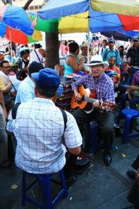 Man playing music on Medellin square Colombia
