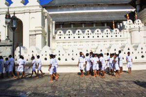 school boys temple of the tooth buddha kandy sri lanka