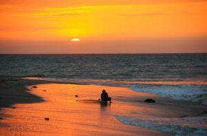 sunset surfing mancora ocean peru