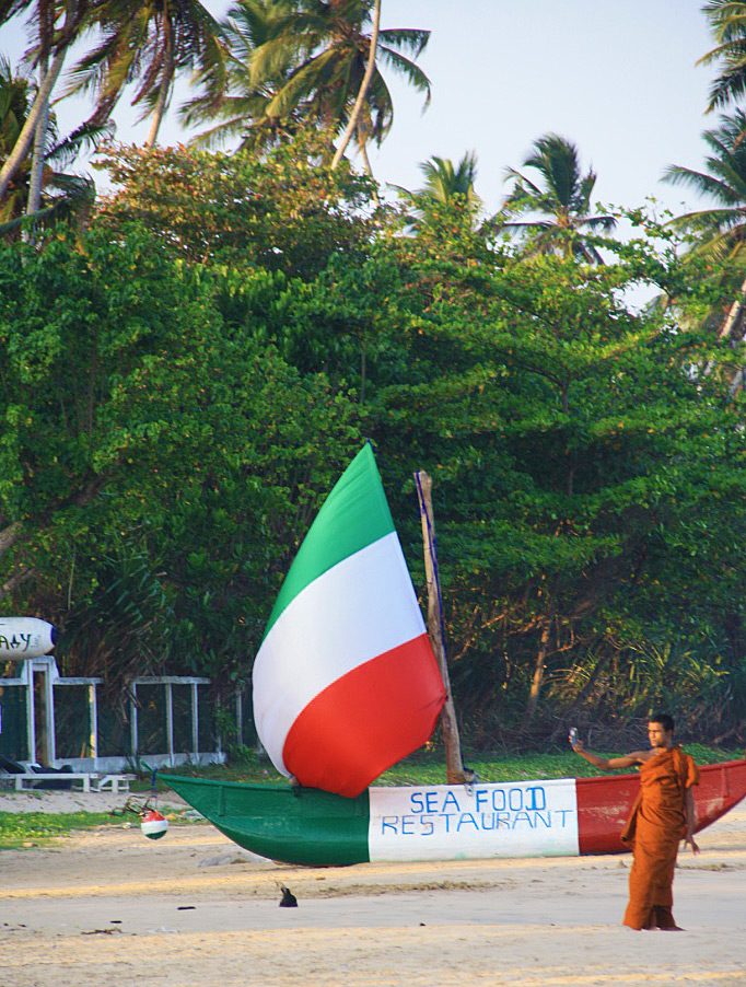 monk taking selfie dickwella beach sri lanka