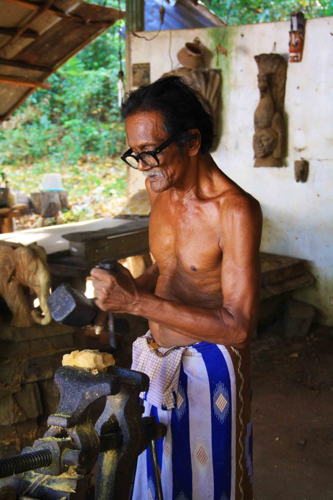 local crafts man sigiriya wood carving sri lanka