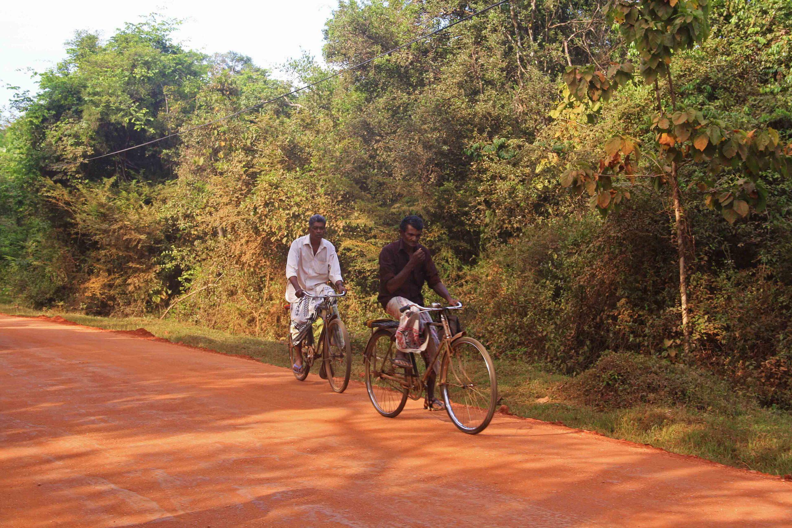 local men cycling sigiriya sri lanka