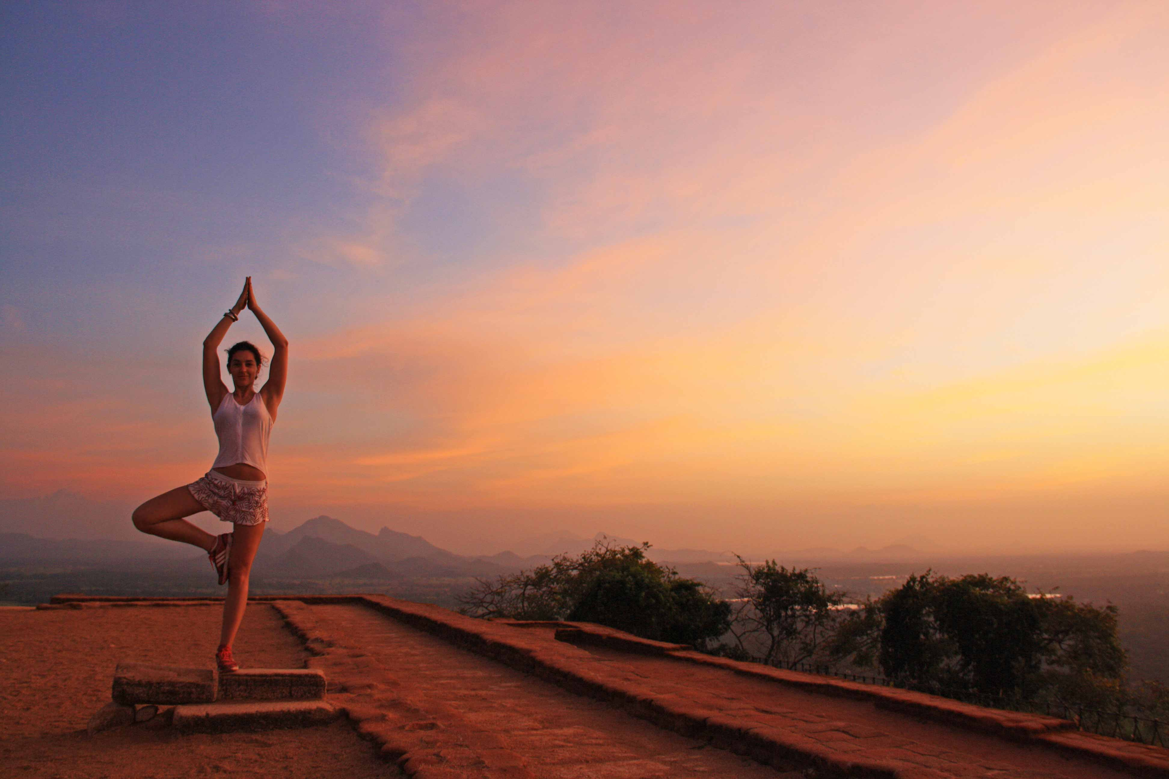 yoga session sigiriya rock sunset sri lanka