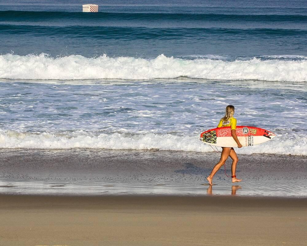 Surfer girl on the beach of Hossegor France