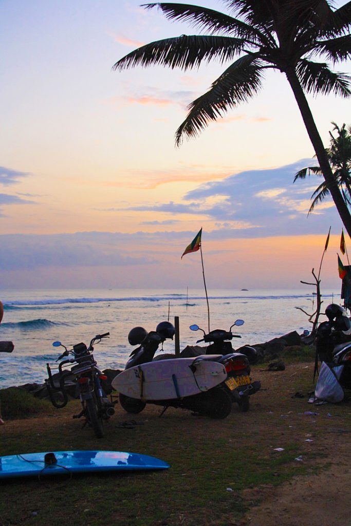 scooter surfing beach ocean palmtrees sunset ahangama sri lanka