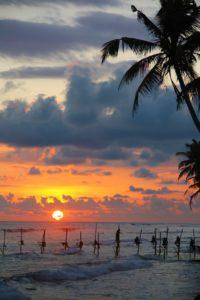 sunset stilt fishermen ocean ahangama sri lanka