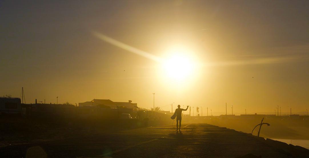 sunrise surfer praia do cabedelo portugal