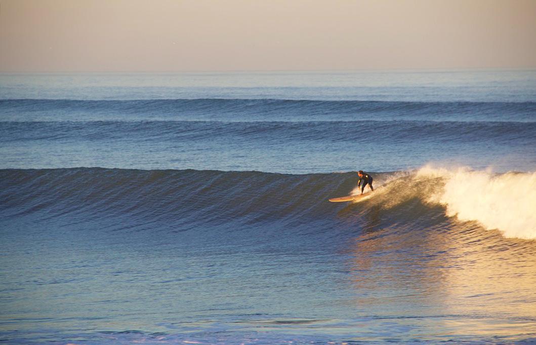 sunrise surfing clean waves praia do cabedelo portugal