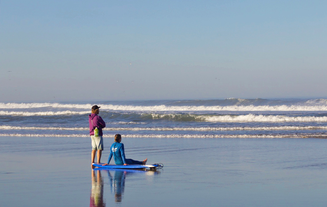 Watching the surf lesson in Praia do Cabedelo Portugal
