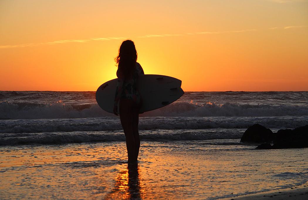 sunset silhouette surfing ocean costa nova portugal