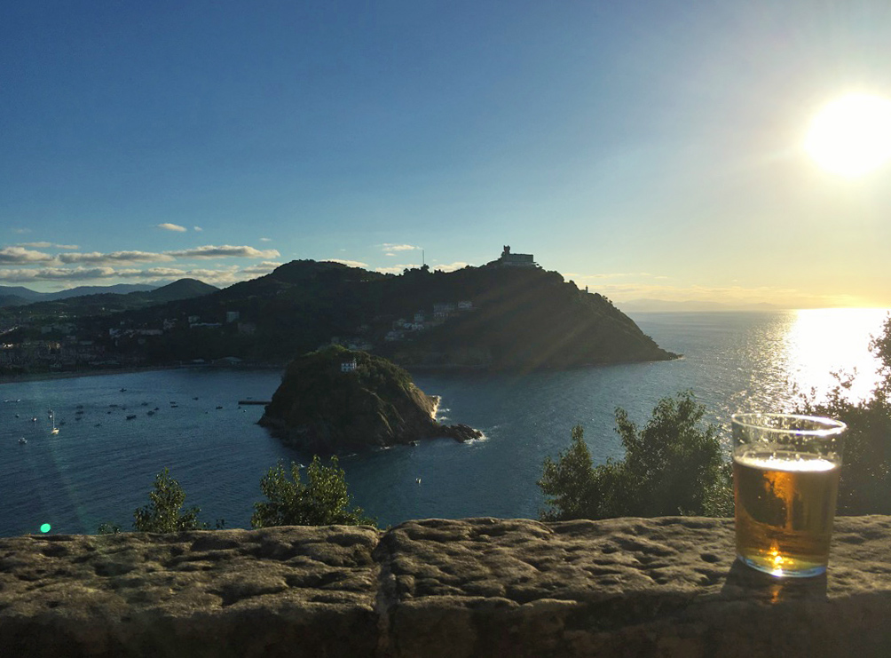 view monte urgull sunset beer san sebastian spain