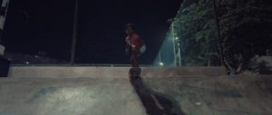 Little indian girl doing a drop in with her skateboard