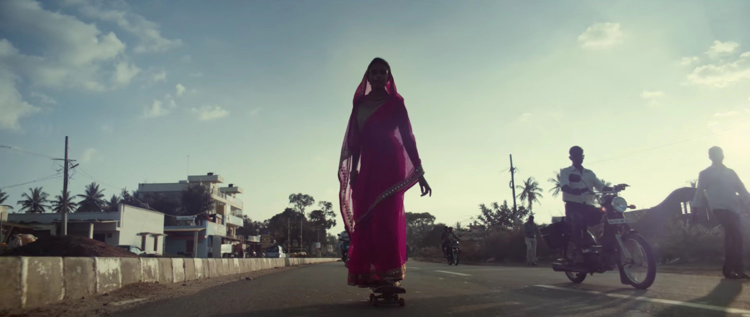 Indian skate culture woman skating through the streets of india