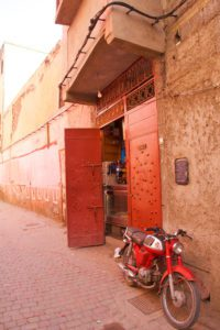 red city motorbike streets marrakech morocco