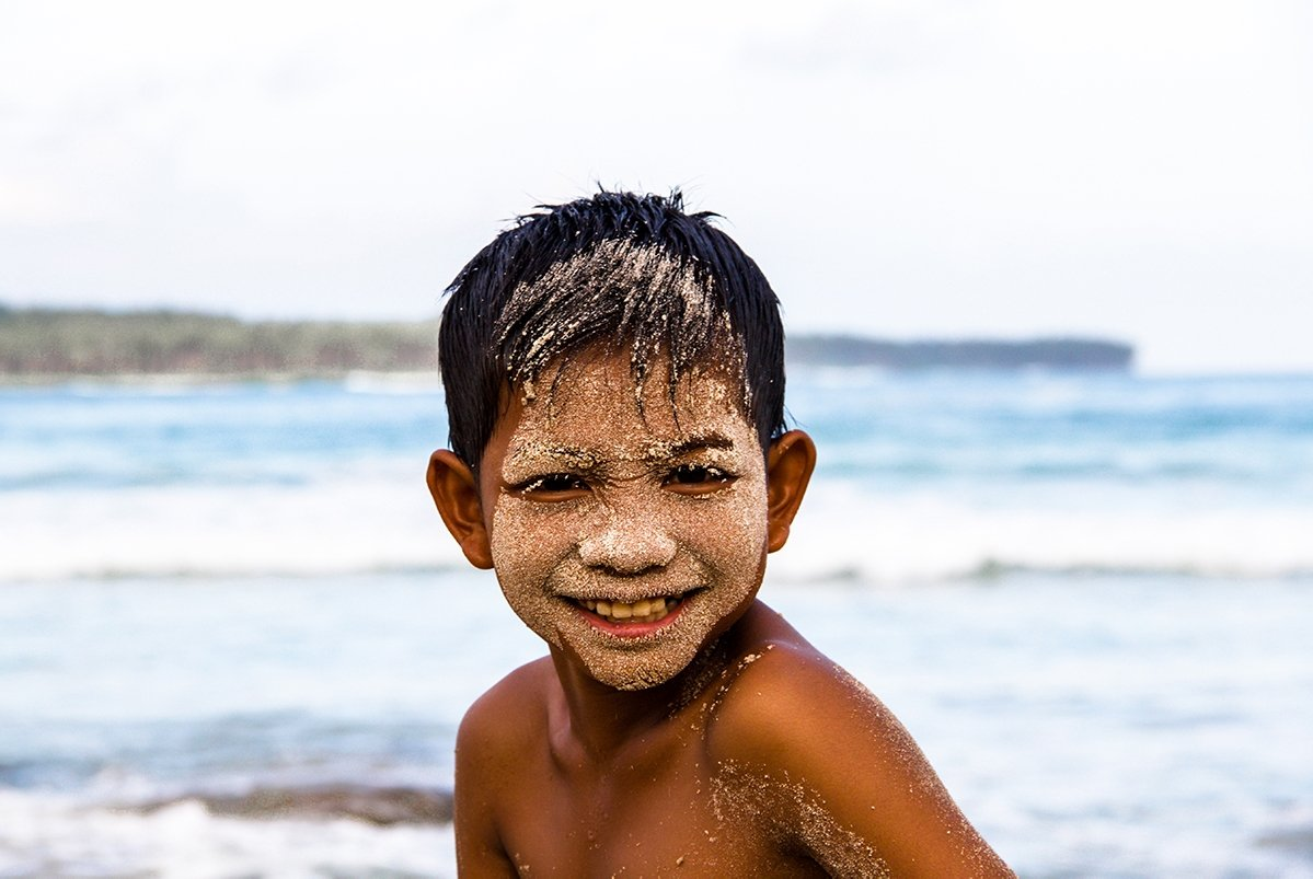 Boy on the beach on Simeulue Island Sumatra