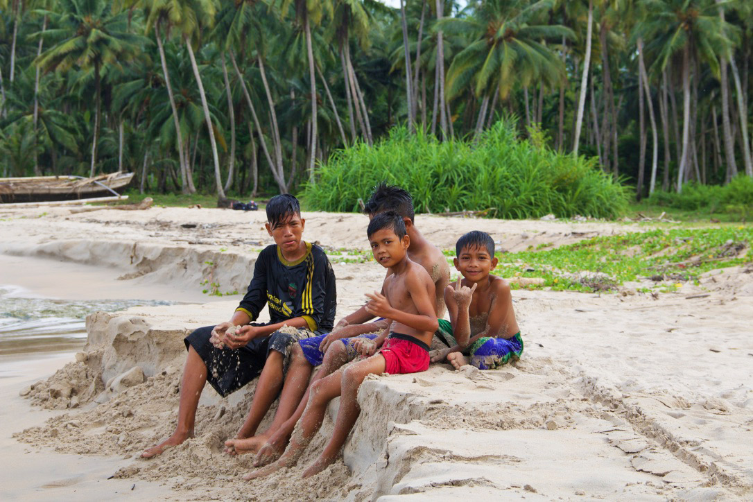 boys beach palmtrees simeulue island sumatra