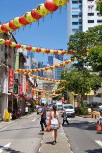 china town street singapore people