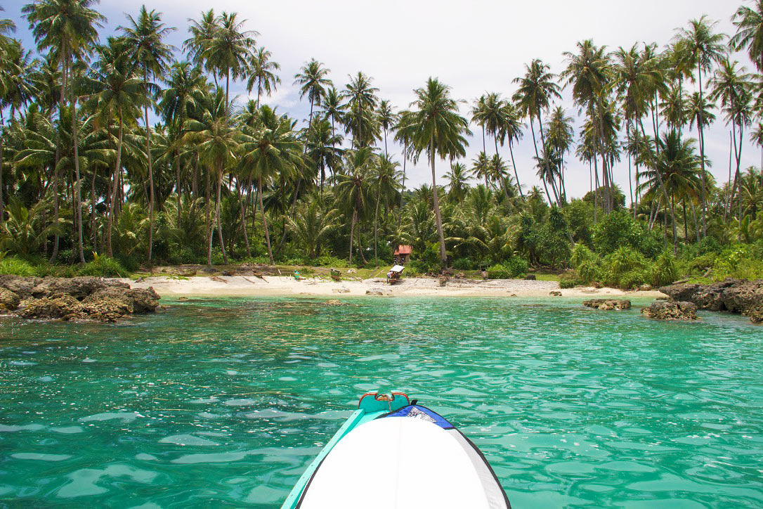 palmtrees boat trip simeulue surf lodges island sumatra