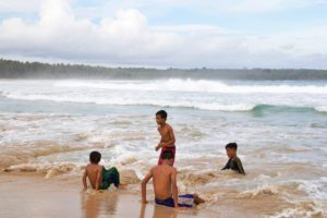 playing boys beach simeulue island sumatra