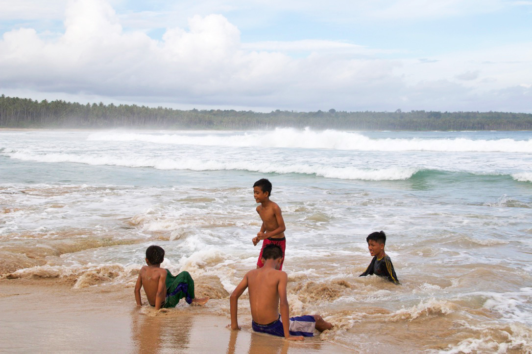 playing boys beach simeulue island sumatra
