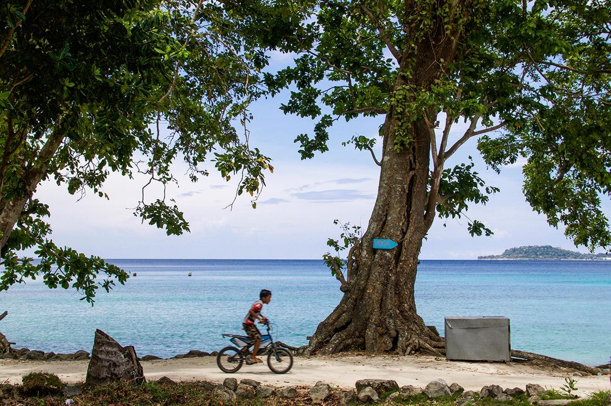 Boy on a bicycle on Gapang beach Pulau Weh